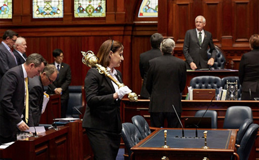 Sergeant-at-Arms about to place the mace on the Table of the Legislative Assembly