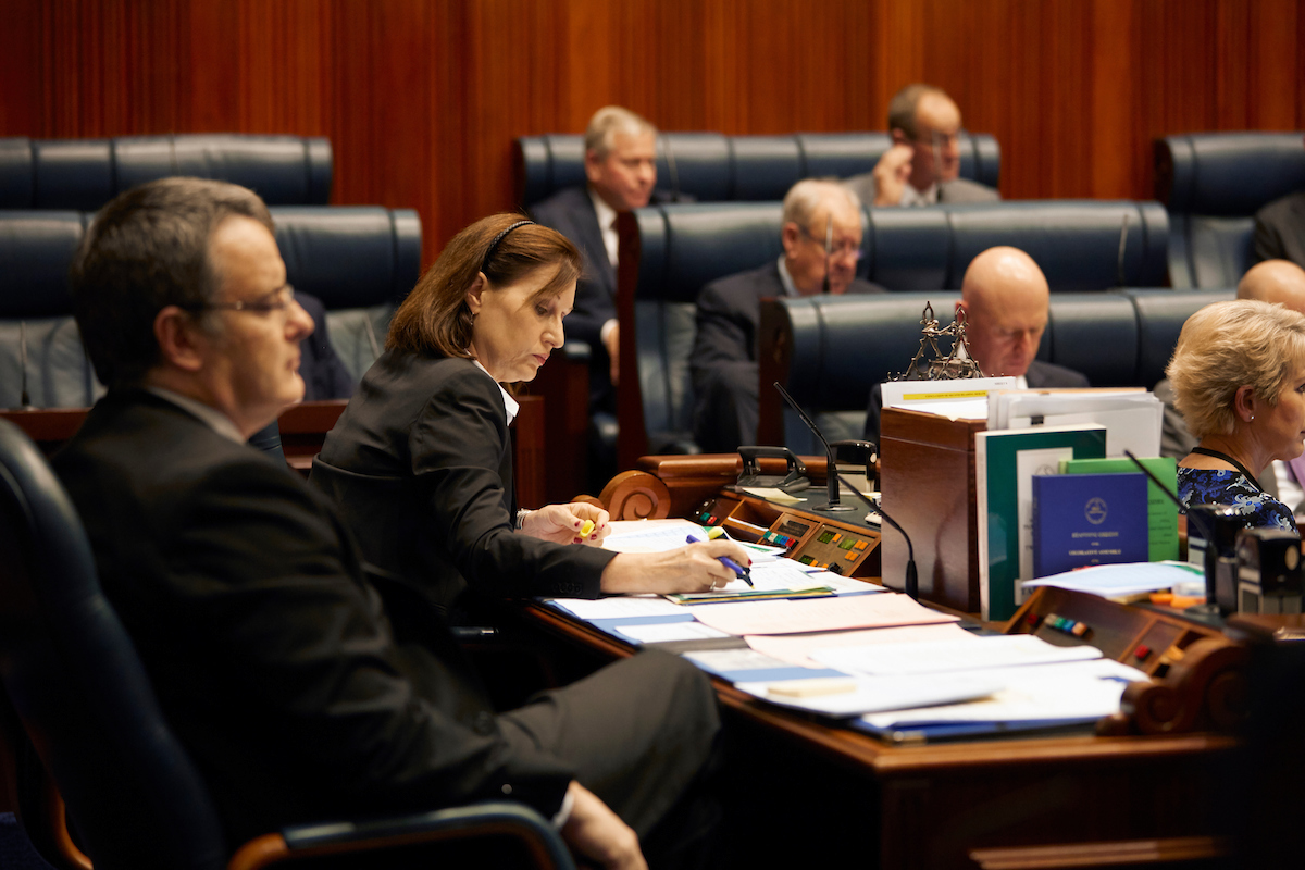 Clerks at the Table recording the minutes of the Legislative Assembly