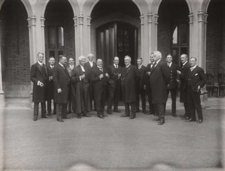 Formally dressed men standing in a line